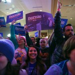 Supporters of Sen. Bernie Sanders watch election returns in a caucus night event for Sanders in Des Moines, Iowa, Feb. 1, 2016. (Photo: Todd Heisler / The New York Times)