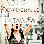 """Sign: """"This is not democracy, it is a dictatorship"""" - Protest in Madrid, Spain. (Photo: Marta Breijo / Flickr)"""