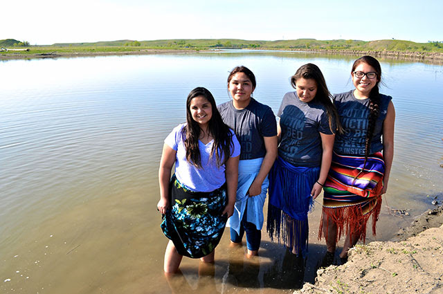 Rezpect Our Water campaign youth leaders (left to right) Tokata Iron Eyes, AnnaLee Yellow Hammer,Precious Winter Roze Bernie, andWinona Gayton stand in defense of land and water. (Photo: Kettie Jean)