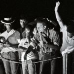 "Stokely Carmichael delivers his ""Black Power"" speech at a rally in Broad Street Park in Greenwood, Mississippi."