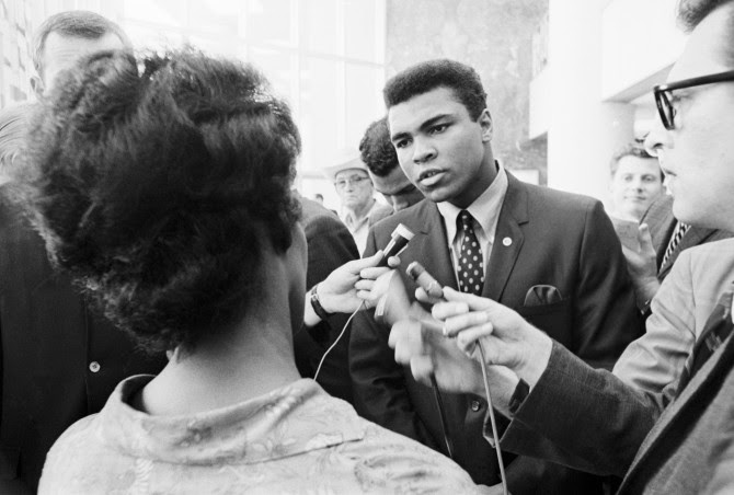 Boxer Muhammad Ali talking with the press after being indicted by a Federal Grand Jury for his refusal to be inducted into the armed forces. Ali contended that he was a Nation of Islam minister and not subject to the draft.