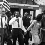 Martin Luther King Jr. (second from left) and his wife, Coretta Scott King, lead a civil rights march from Selma, Ala., to the state capital in Montgomery in March 1965. On the left is  diplomat Ralph Bunche.