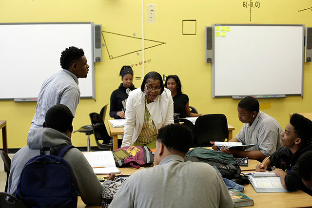Tonya Ray, center, a math teacher at the Academy of Public Leadership, talking with students in Detroit, May 11, 2016.  (Joshua Lott / The New York Times)
