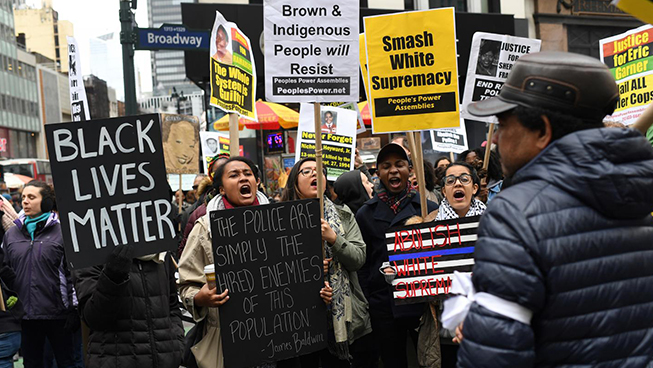 Activists attend a Black Lives Matter protest in Manhattan against President Donald Trump and New York Mayor Bill de Blasio on April 1