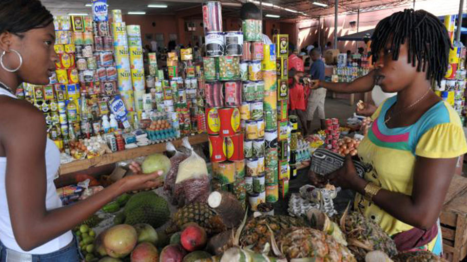 A woman shops in a market in Cabinda, Angola, on Jan. 19, 2010.