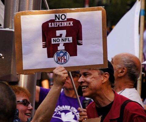 Standing with Colin Kaepernick - Photo By Bud Korotzer