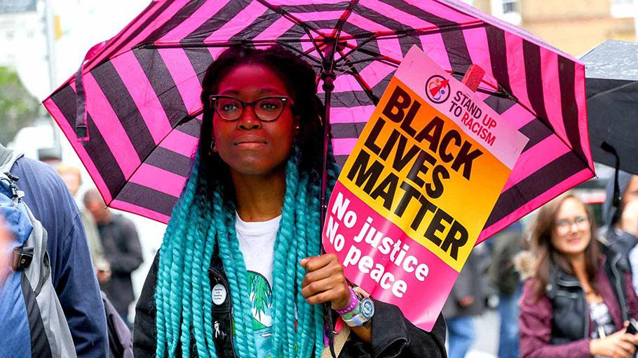 Protester with Black Lives Matter placard at a vigil for Rashan Charles, London, UK, July 29, 2017