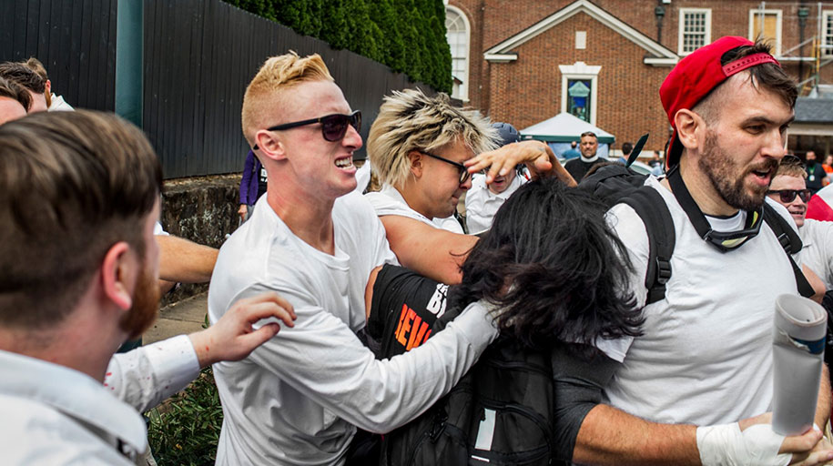 """RAM member Ben Daley (center) attacks an unidentified woman at the """"Unite the Right"""" rally on Aug. 12, 2017, in Charlottesville, Virginia."""