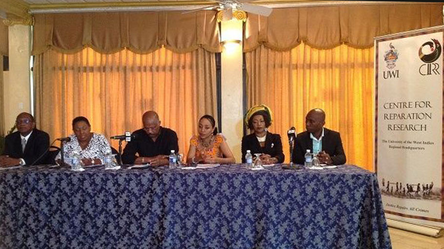 "Sir Hilary Beckles (third from left) said ""the colonial mess left behind... has overwhelmed the efforts... to achieve sustainable economic development"". Photo: Earl Bousquet"