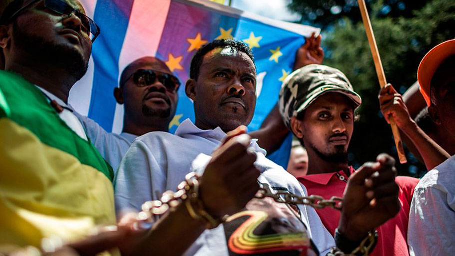 Members of the Africa Diaspora Forum (ADF), civil society organisations, churches, trade unions and other coalitions wear chains and shout slogans during a demonstration against the slave trade and human trafficking in Libya on December 12, 2017, at the Union Buildings in Pretoria