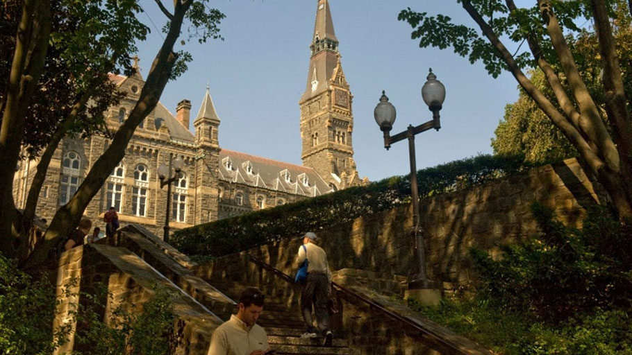 Students mill around the campus of Georgetown University.