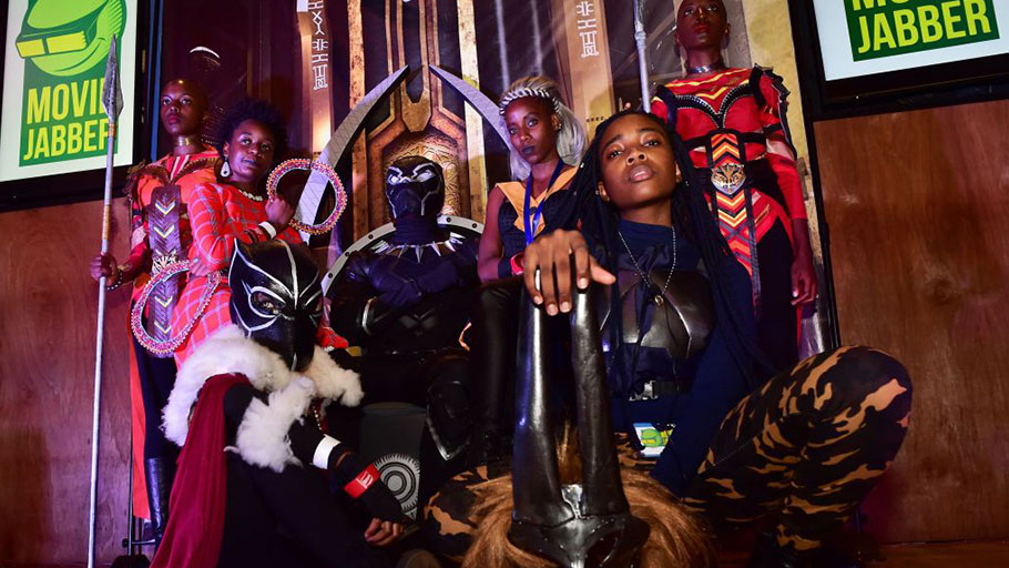 Cosplayers portraying characters from the 2018 US superhero film based on the Marvel Comics character, Black Panther, pose in the Kenyan capital, Nairobi on February 14, 2018