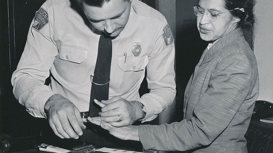 Rosa Parks being fingerprinted by Deputy Sheriff D.H. Lackey after being arrested for boycotting public transportation