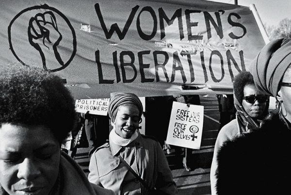 "A group of women, under a ""Women's Liberation"" banner, march in support of the Black Panther Party, New Haven, Connecticut, November 1969."
