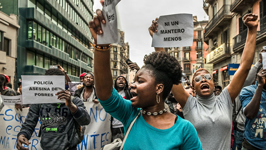 Women demonstrate with street vendors in memory of Mame Mbaye in Madrid, Spain, on March 16, 2018. Hundreds of people, mostly black, protested in Barcelona by the death of Mame Mbaye, street vendor in Madrid who lost his life after the harassment by the municipal police of Madrid