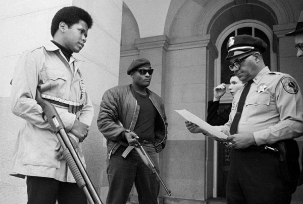 Two members of the Black Panther Party are met on the steps of the State Capitol in Sacramento, May 2, 1967, by Police Lt. Ernest Holloway, who informs them they will be allowed to keep their weapons as long as they cause no trouble and do not disturb the peace. Earlier several members had entered the Assembly chambers and had their guns taken away.