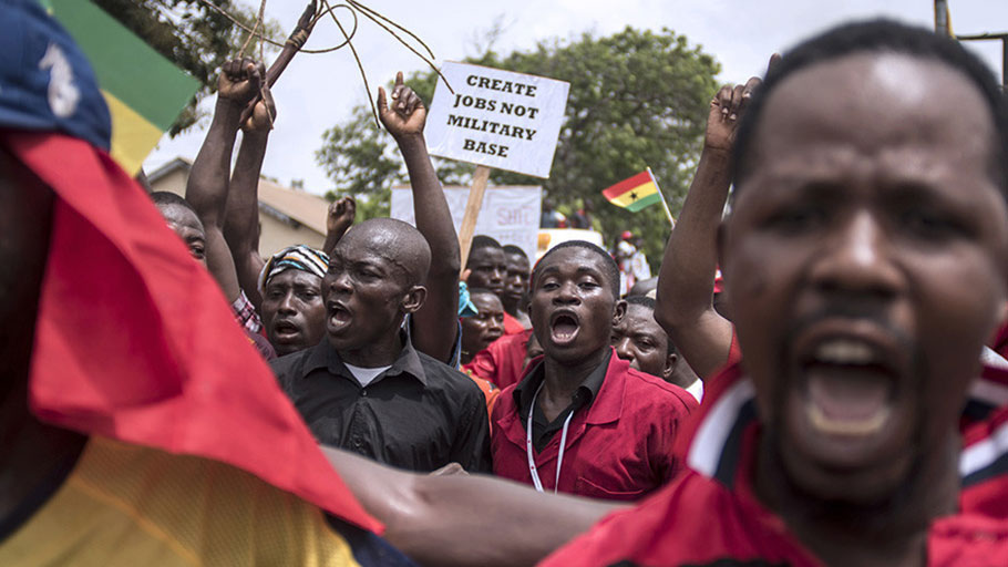 Demonstrators carry banners as they march during a protest in Ghana's capital Accra, March 28, 2018