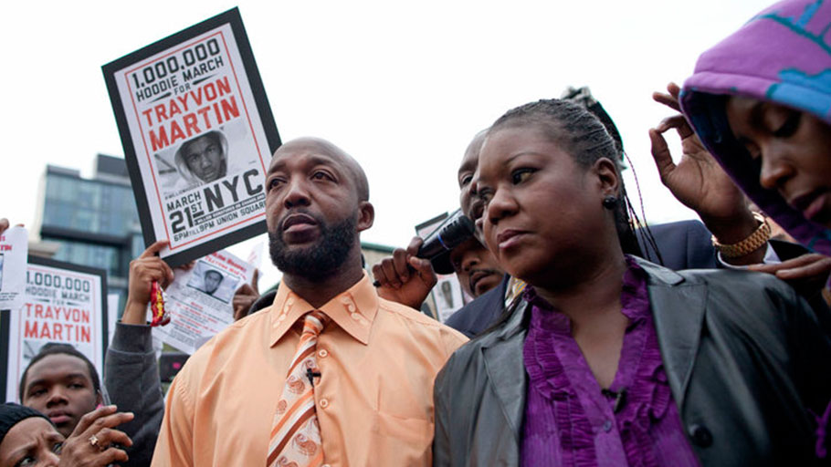 Tracy Martin, left, father of slain Florida teen Trayvon Martin, and Sybrina Fulton, Trayvon's mother, join the Million Hoodies March in New York's Union Square on March 21, 2012, to demand justice for their son's death.