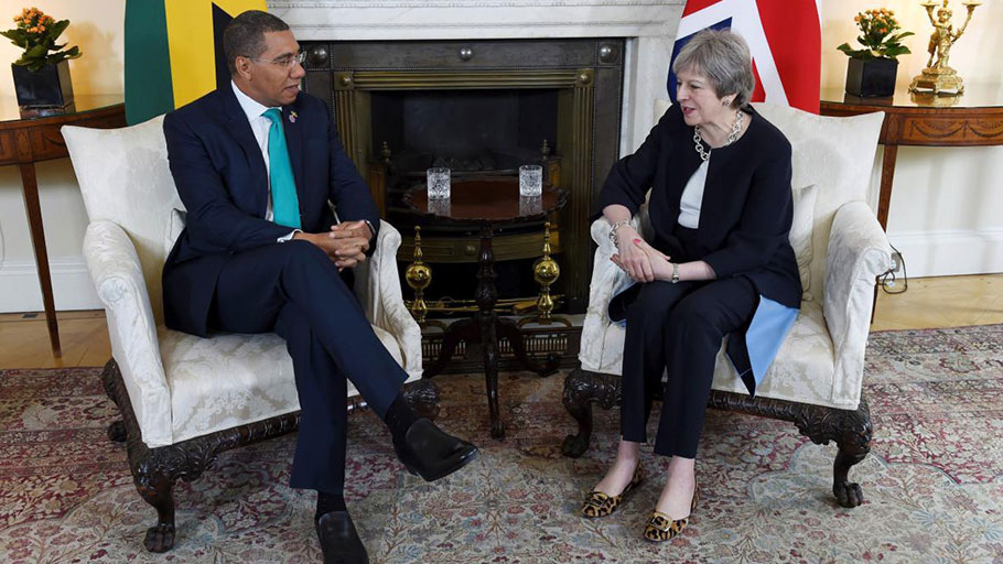 Britain's Prime Minister Theresa May and Prime Minister of Jamaica Andrew Holness speak during a bilateral meeting at 10 Downing Street, London, Tuesday April 17, 2018