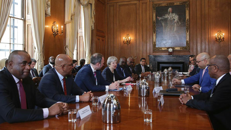 "Britain's Prime Minister Theresa May, centre left, hosts a meeting with leaders and representatives of Caribbean countries, inside 10 Downing Street in central London, Tuesday April 17, 2017, on the sidelines of the Commonwealth Heads of Government meeting (CHOGM). May met with Caribbean leaders and envoys Tuesday, and told them ""we are genuinely sorry for any anxiety that has been caused"" personally apologizing for the treatment of long-term U.K. residents from the Caribbean who have been asked to prove their right to stay in the country."