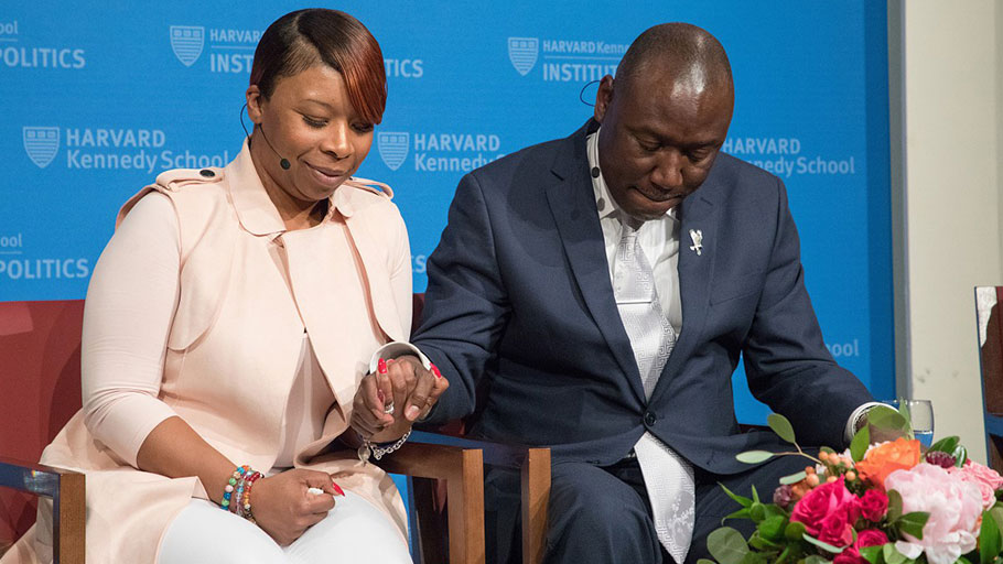 Lezley McSpadden, mother of Michael Brown, prays with Benjamin Crump, attorney for the families of Brown, Trayvon Martin, and Stephon Clark, at the IOP's forum on the Black Lives Matter movement four years after Brown's slaying.