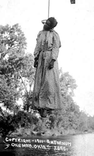 Lynching of Laura Nelson, May 1911, Okemah, Oklahoma, presented as a photo postcard. Stamp on reverse reads 'unmailable'. Photograph: George Henry Farnum/1911