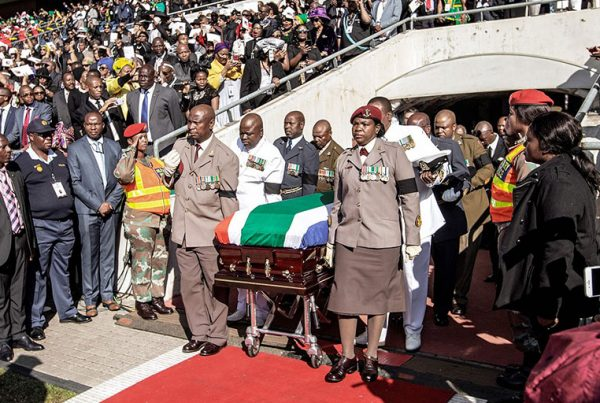 South African military personnel bring in the coffin at Orlando Stadium in Soweto for the funeral ceremony of Winnie Madikizela-Mandela.