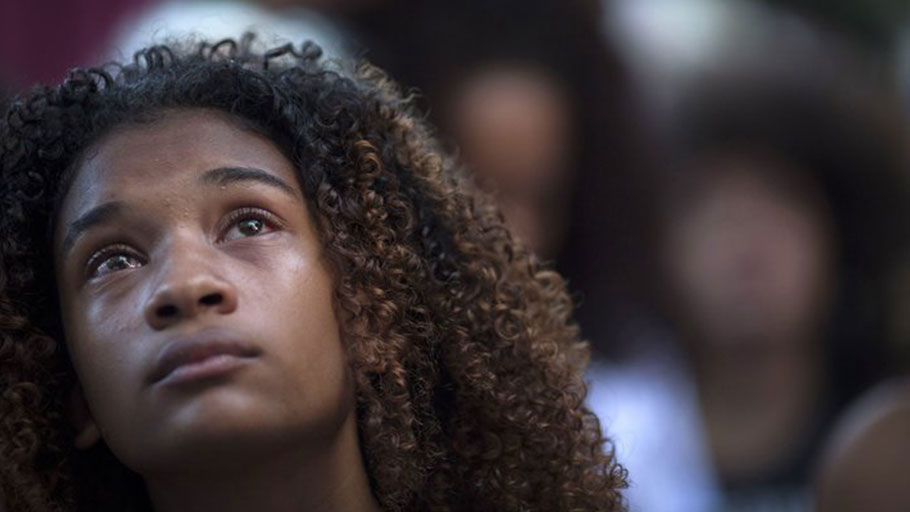 A protester cries during a March 20 demonstration against the killing of Marielle Franco in front of the Municipal Chamber of Rio de Janeiro.