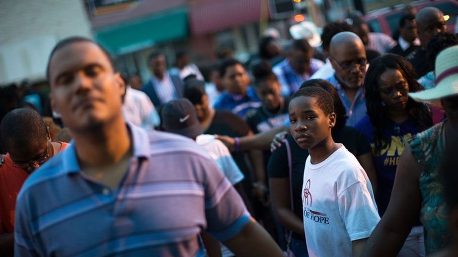 A young boy stands at a Black Lives Matter prayer vigil on the steps of the First Baptist Church, a predominantly African-American congregation, in Macon, Georgia