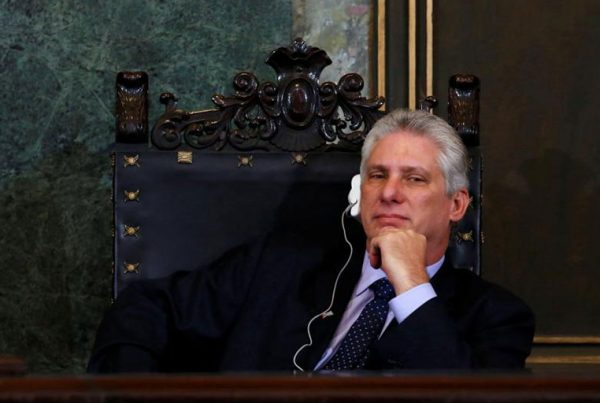 Cuba's First Vice-President Miguel Diaz-Canel listens to Vietnam's Communist Party Secretary General Nguyen Phu Trong at University of Havana.