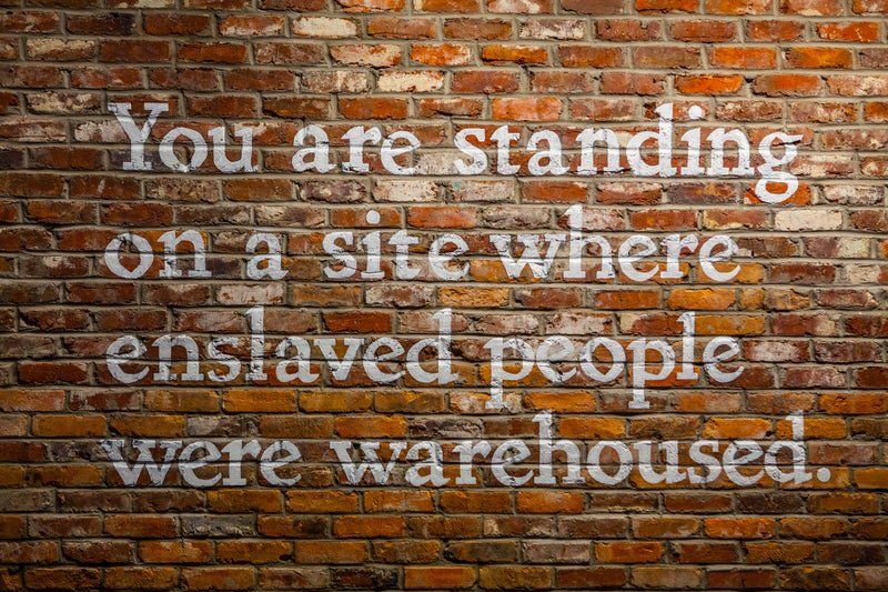 You are standing on site where enslaved people-were warehoused.