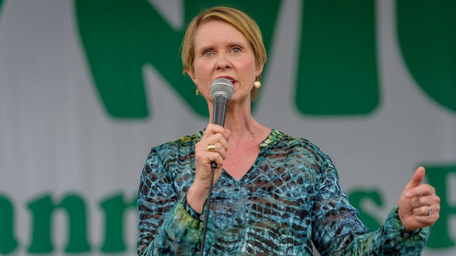 "ew York gubernatorial candidate Cynthia Nixon speaks at the NYC Cannabis Parade and Rally on May 5, 2018. Nixon has been criticized by black leaders for saying that marijuana licenses could be a ""form of reparations."""