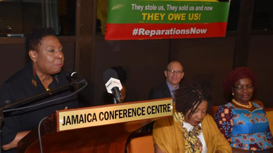 Photo: Mark Bell Minister of Culture, Gender, Entertainment and Sport, Hon. Olivia Grange (at podium), speaks at Reparation Youth Conference, held at the Jamaica Conference Centre in downtown, Kingston, on Friday (May 25). Seated (from left) are: Co-Chair, National Council on Reparations in Jamaica, Professor Verene Shepherd and Nigerian High Commissioner to Jamaica, Her Excellency Janet Olisa. In the background is Charge D'Affaires at the South African High Commission, Mr. Phillip Riley.