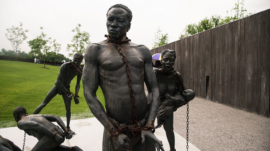 A sculpture of enslaved people at the entrance to the National Memorial for Peace and Justice.