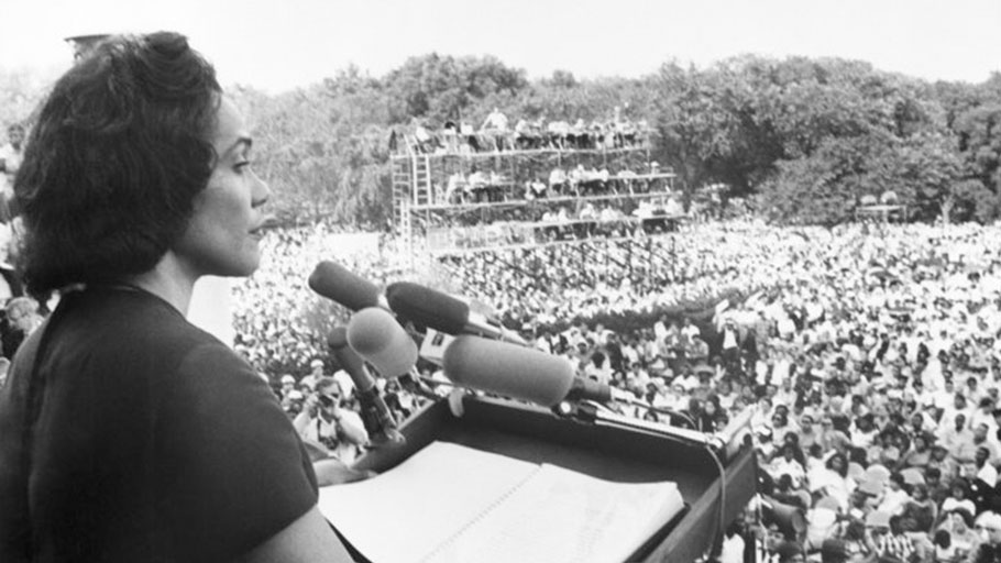 "Coretta Scott King addressing a Poor People's Campaign rally from the steps of the Lincoln Memorial on June 19, 1968. She told the nearly 50,000-strong crowd that ""racism, poverty and war"" combined to make matters worse for poor black and white people alike."