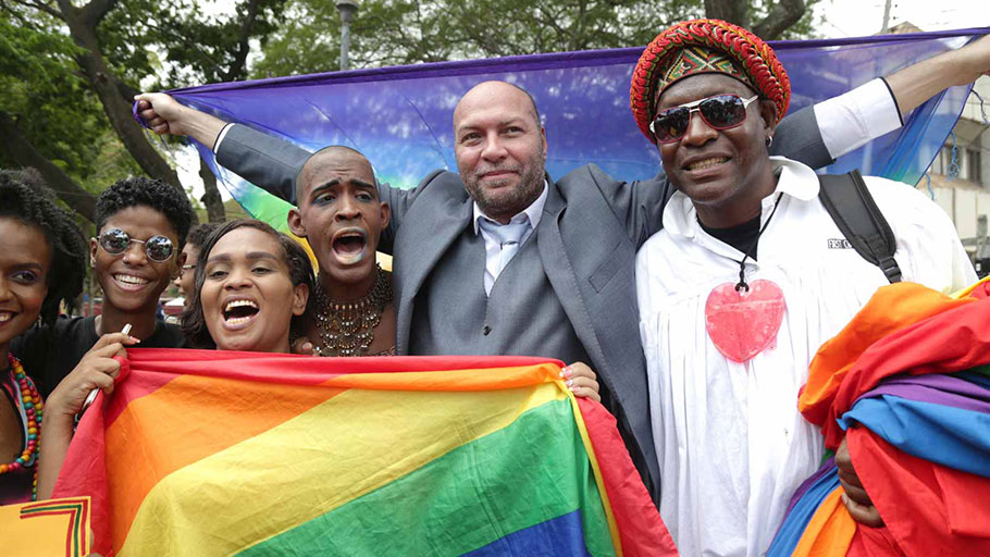 Activist Jason Jones celebrating with others after Trinidad and Tobago's High Court ruled against the country's anti-homosexual laws, outside the Hall of Justice, Port of Spain, Trinidad and Tobago, April 12, 2018