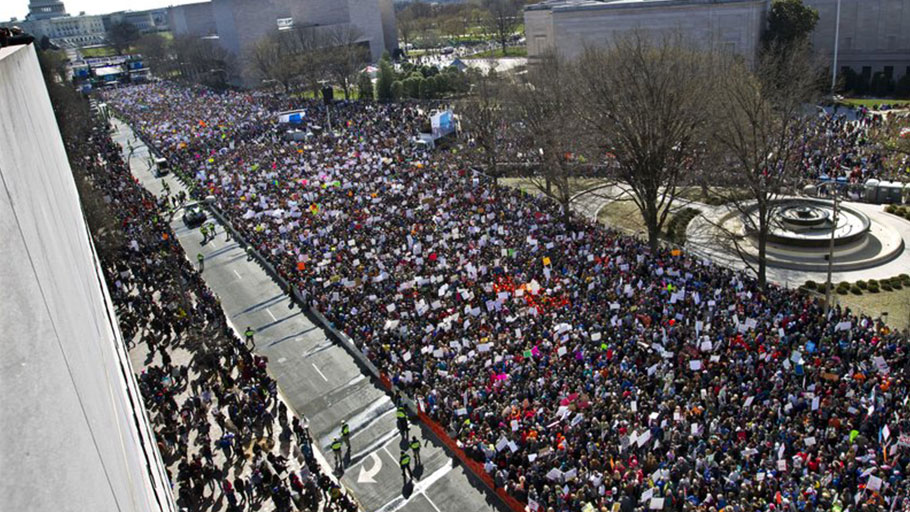 "In this March 24, 2018 file photo, protesters fill Pennsylvania Avenue, as seen from the Newseum, during the ""March for Our Lives"" rally in support of gun control in Washington. Rachel Einwohner, a Purdue University sociology professor, says, ""With the rise of social media, it's definitely a lot easier for people to mobilize more quickly and you don't necessarily need to have one charismatic leader like Dr. King, who had almost some kind of magical quality… But you still do need some powerful message that really resonates with a lot of people."""