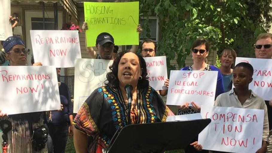Sonja Bonnett and other members of the Coalition to End Unconstitutional Tax Foreclosures in front of Bonnett's new Detroit home, which the group acquired for her.