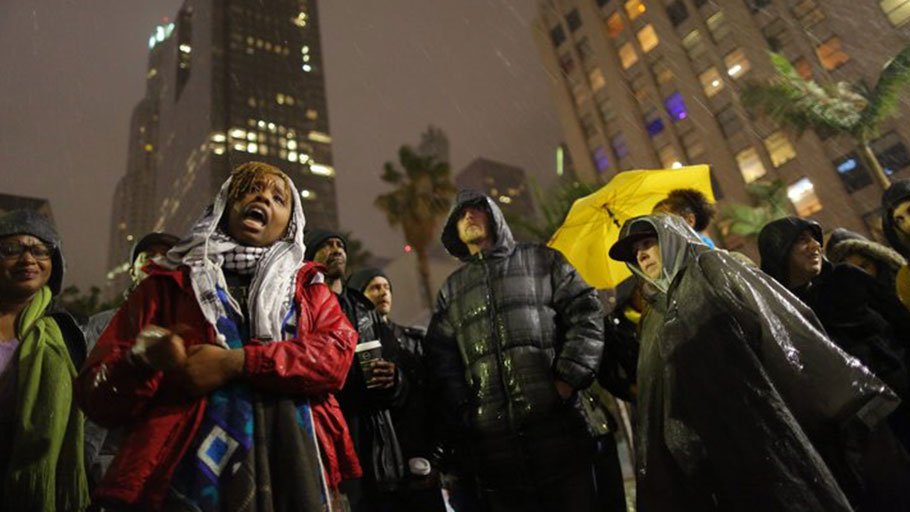 The author, Patrisse Cullors, speaks to people gathered to protest the Los Angeles Police shooting of a homeless man on March 1, 2015 in Los Angeles, California.
