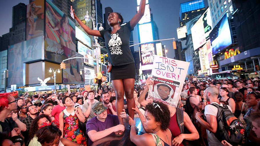 Trayvon Martin supporters rally in Times Square while blocking traffic after marching from a rally for Martin in Union Square in New York, on July 14, 2013. George Zimmerman was acquitted of all charges in the shooting death of Martin on July 13, 2013. Many protesters challenged the verdict.
