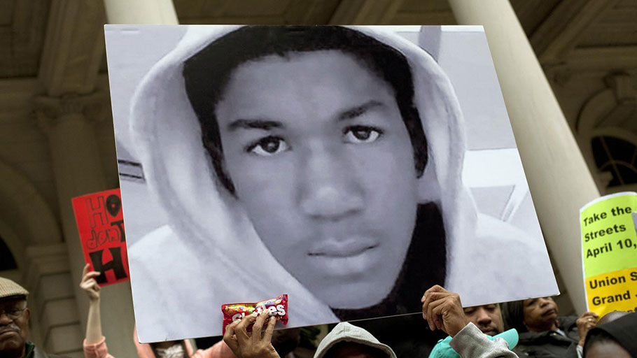 People attend a press conference along with New York City Council members to call for justice in the February 26, 2012, killing of 17-year-old Trayvon Martin in Sanford, Florida, on the steps of City Hall, in New York, on March 28, 2012.