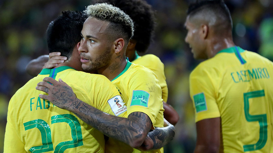 Neymar da Silva Santos Júnior, center, celebrating a goal with his teammates during Brazil's World Cup match against Serbia on Wednesday.