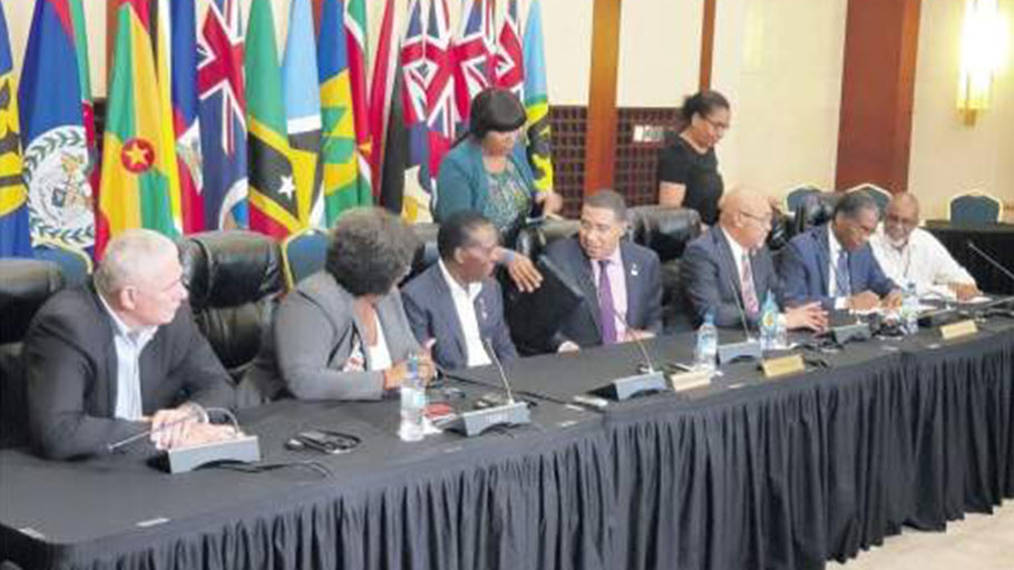 Jamaica's Prime Minister Andrew Holness (fourth left) strikes up a conversation with (from left) St Lucia's Prime Minister Allan Chastinet, Barbados' Prime Minister Mia Mottley and Grenada's Prime Minister Dr Keith Mitchell before the start of Friday night's press conference. (Photo: Anthony Lewis)