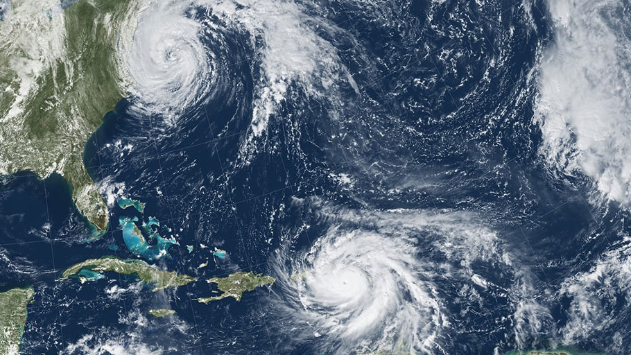 Hurricanes Katia (left), Irma (center) and Jose (right) in September 2017 – the first time on record that three major hurricanes made landfall at the same time in the Caribbean. Photograph: GOES-13 and MODIS/NASA/NOAA