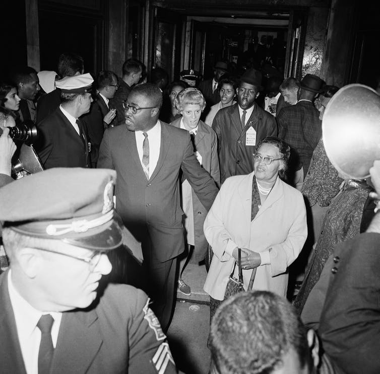 Forty-five NAACP members leave headquarters of Boston's school committee on Sept. 7, 1963, after staging a sit-in protesting segregation in Boston schools. AP Photo