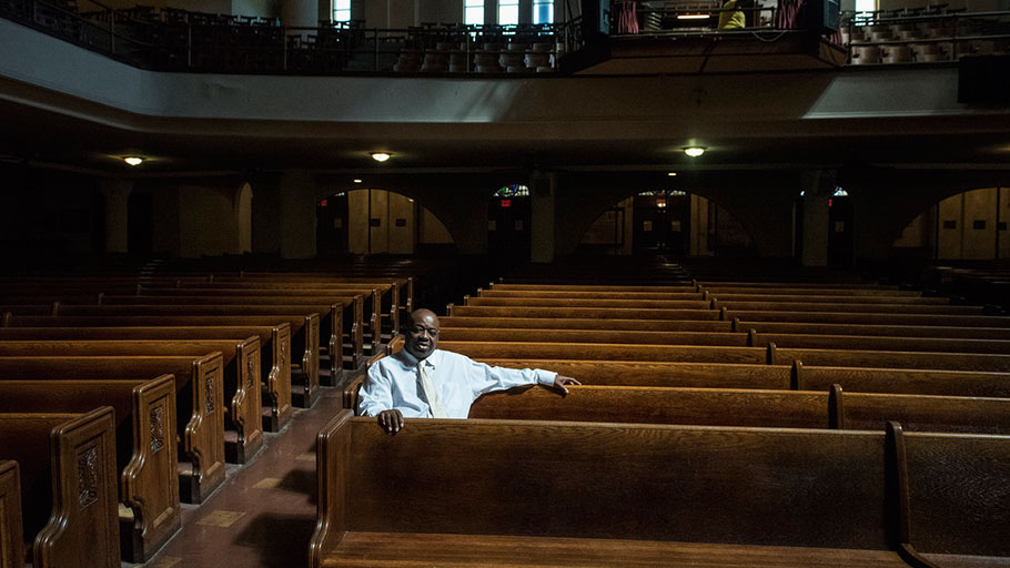 Rev. Robert Johnson, who grew up in the neighborhood, now presides over Tindley Temple United Methodist, an historic black church that is down to 150 regular congregants.
