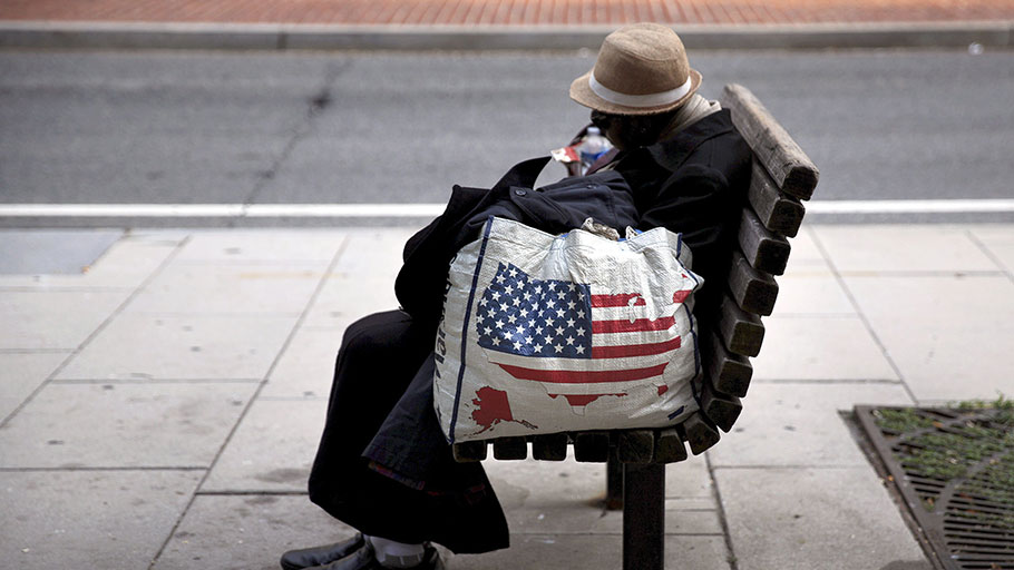 A homeless woman sits on a bench a few blocks away from the White House, Washington, 1 September 2015. Photo by Carlos Barria/Reuters
