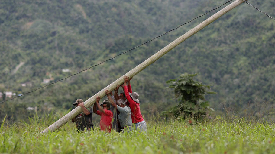 Some Puerto Ricans had to restore downed power lines themselves after Hurricane Maria.