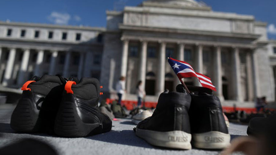 Activists put empty shoes outside the capitol building in San Juan, Puerto Rico, June 2018 to convey the toll of Hurricane Maria after a study estimated that the 2017 storm took thousands, not dozens, of lives.