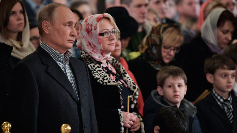 Russian President Vladimir Putin attends a mass in his hometown of St. Petersburg, Russia, on Jan. 7, 2018